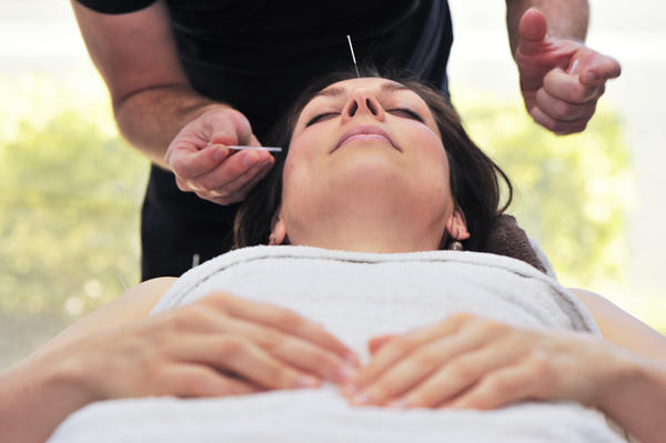 Are acupuncturists doctors or therapists?