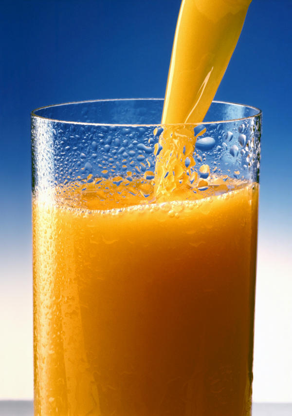 What is the daily recommended serving of juice for an average adult?