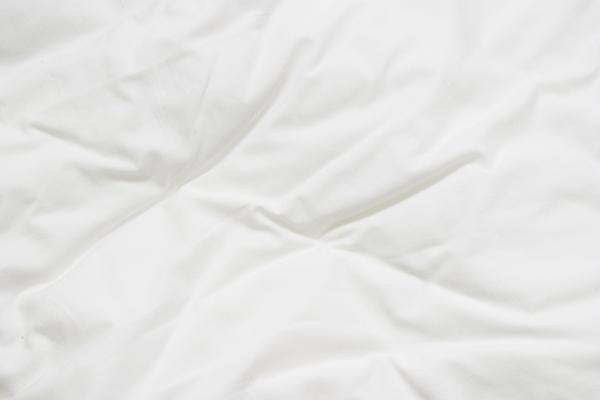 How can I prevent bed bugs from coming home with you from an infested hotel?