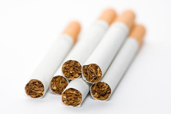 Can smoking cigarettes while on Buspar (buspirone) have unwanted effects?