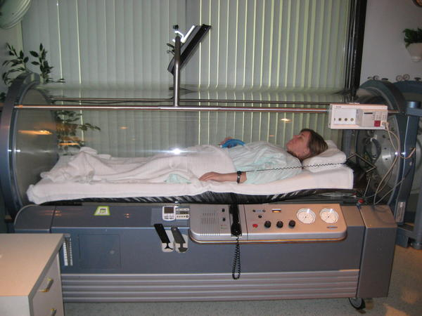 What treatments can be helped by hyperbaric oxygen therapy?