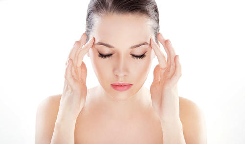 What are the symptoms of tension headache?