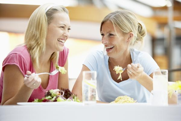 What are some tips for healthy eating when going out to a restaurant or party?