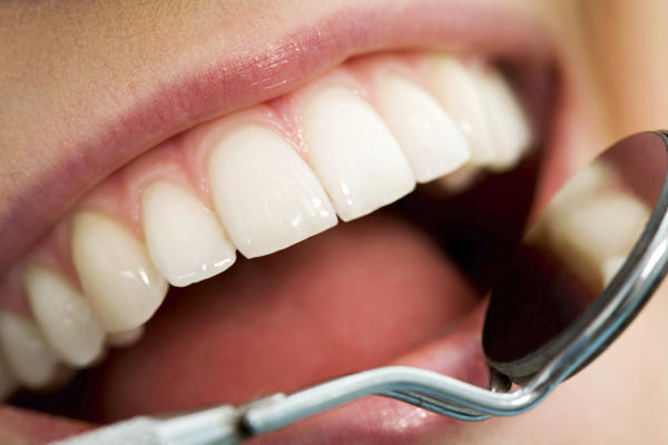 What procedure is necessary when gums are swollen and begin to grow above wisdom teeth, sensitive and start to have bad breath?