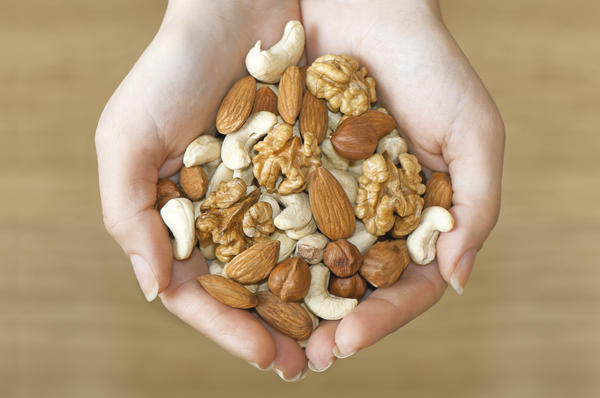 I have a nut allergy. Can touching certain dog food containing nuts, or using cosmetics with shea nut oil cause a reaction?