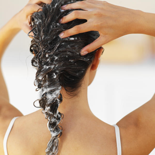 How can you most effectively remove head lice in a long haired 11 year old female?