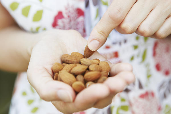 When doctors say it is healthier to snack on nuts, do they also mean peanuts, Corn Nuts, or pine nuts? Those 3 are not truly nuts, right?