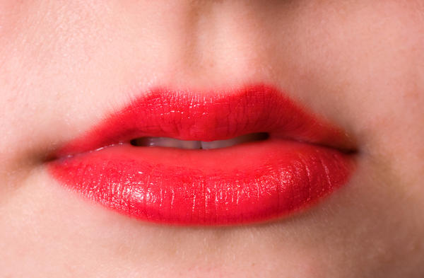 What causes lip discoloration?