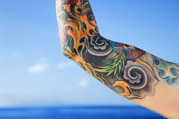 What to do if I have tattoo of flowers on my arms is that ok?