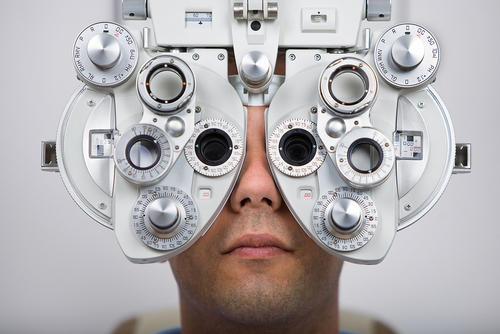 How are eye vision test generally scored?