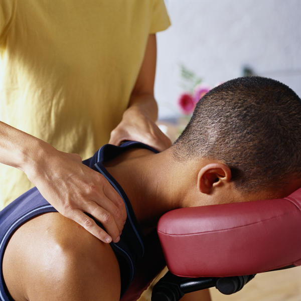 Can a person manually massage his leg to help with lymphedema?
