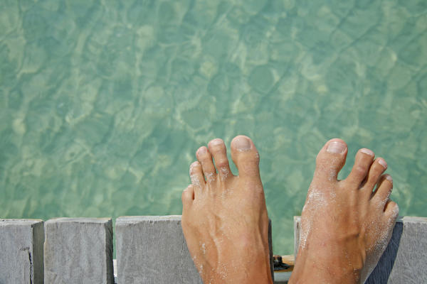 How can you get rid of a callous on your toe?
