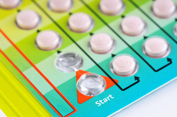 Can taking estrogen stop menstrual bleeding or spotting in between periods if on birth control?