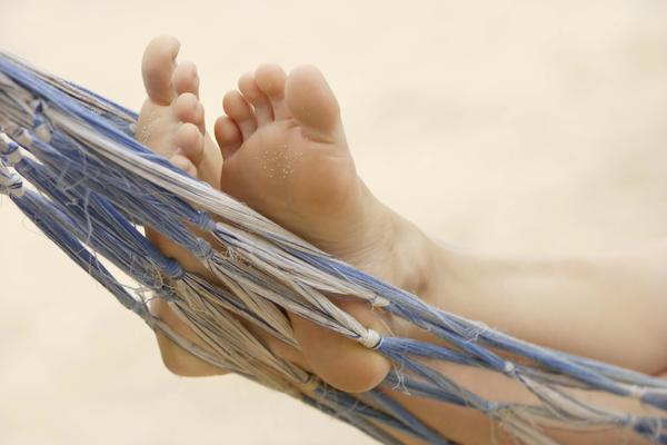 What can cause the sensation of tingling in the arch of my foot?