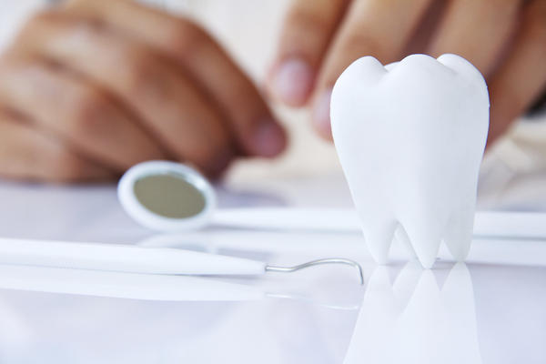 What are some signs that the tooth decay is still active?