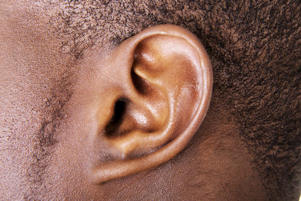 What can cause an asymmetrical ear?