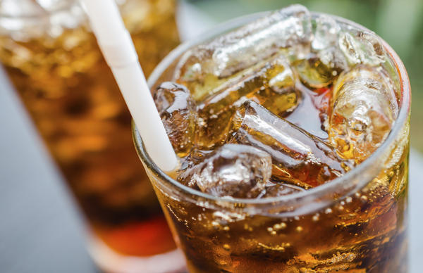 Can drinking regular soda and diet soda or carbonated natural flavored drinks healthy?