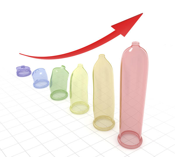 What can cause a tingling sensation and irritation on the tip of the penis?