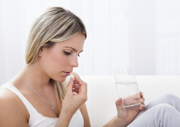 Could you tell me if my antibiotics caused an oral yeast infection, do I stop taking them?