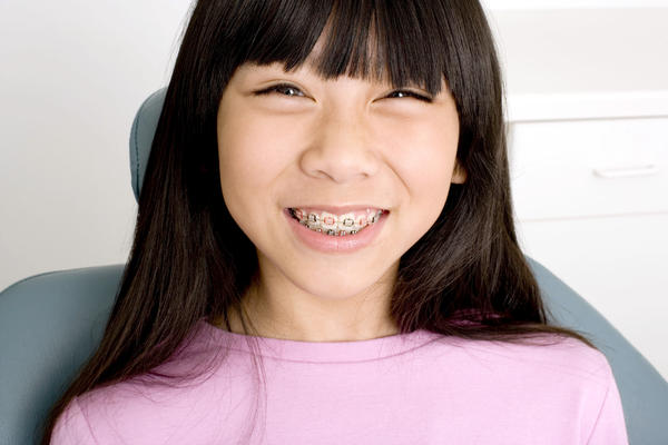 Waterpik vs flossing with someone with braces, which is more effective?