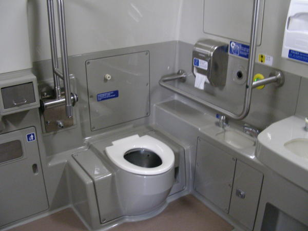 How should you use toilet on a train?