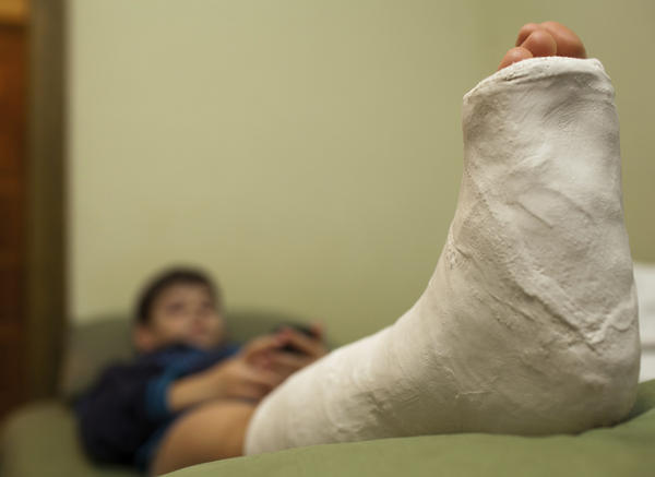 What are the causes of swollen ankles after foot surgery?