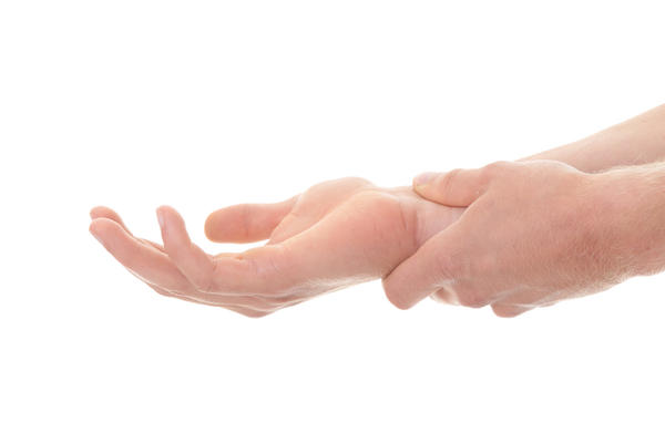 How can I calm or stop hand tremors?