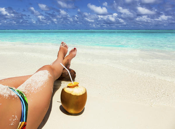 How does coconut oil help with a sunburn?