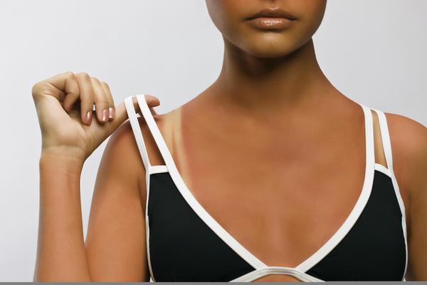 Which is better for you? A spray-on tan or a tan from a tanning bed?