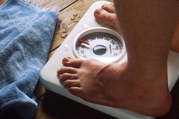 Could it happen that a person weigh with a high body mass index and still have low body fat according to the digital scale?