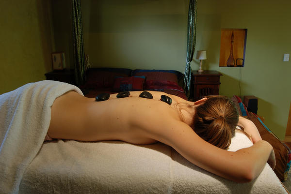 Which acupressure-points do I need to massage to help my back muscles relax?