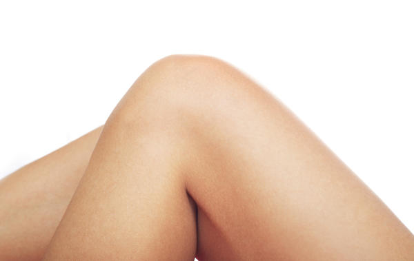 What could a squishy lump on my knee cap be? It hurts when I'm on my knees, but not when I'm walking or standing.