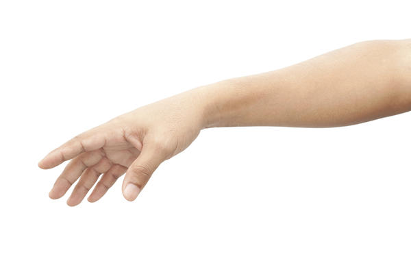 What can cause a swollen arm?
