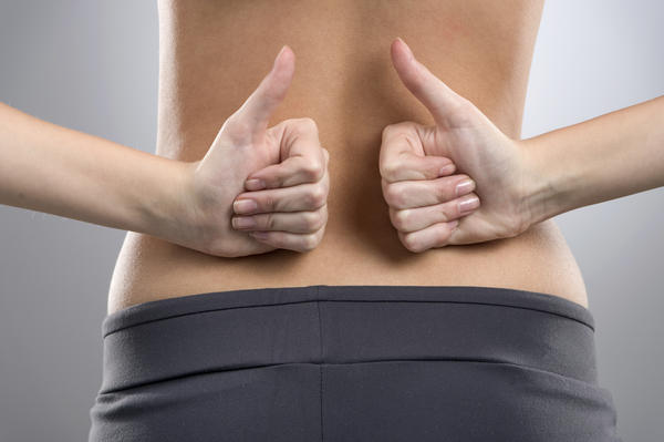Lower back pain on left side numbness in my abdomen ?