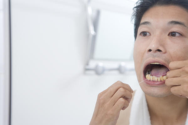 What should I do about bleeding gums when using crest prohealth mouthwash?