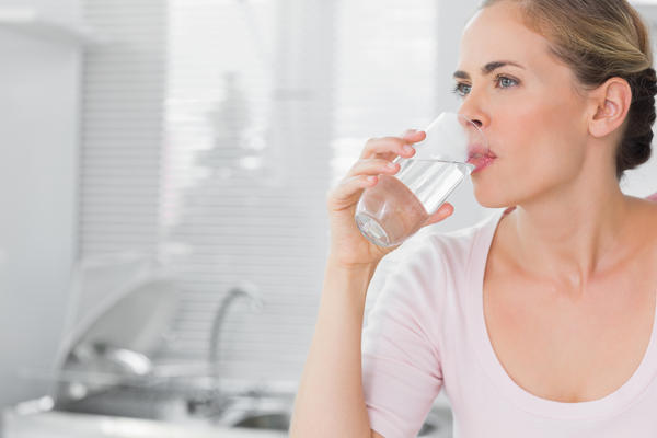 For the past 4 months I have been nauseous every morning, and it would go away as soon as I drink water. What does this mean?
