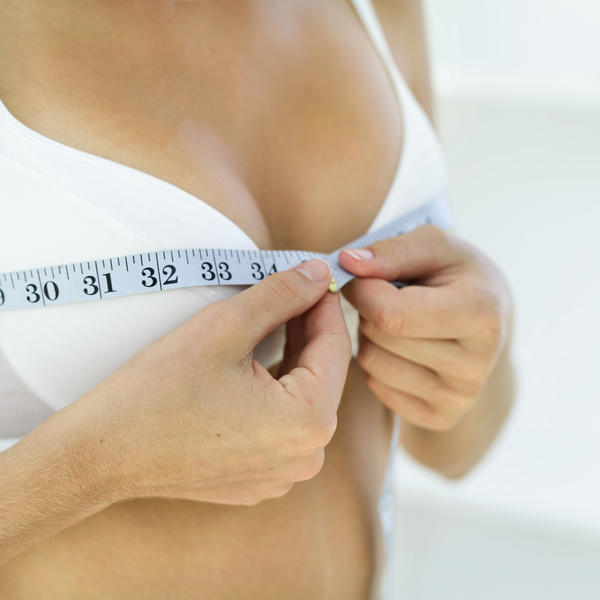Does breast augmentation under the muscle look better years later than one on top of muscle?