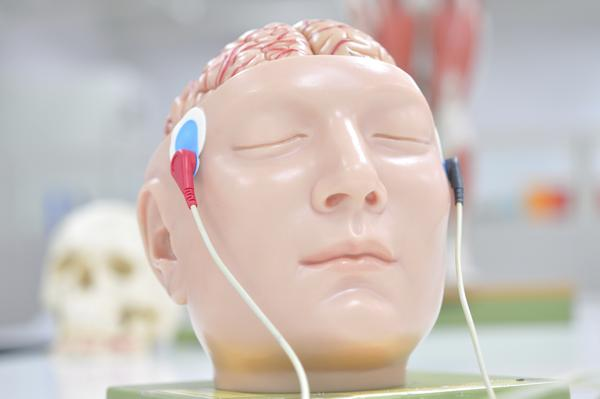 What could an automated external defibrillator do if the pads where placed on either side of the brain?