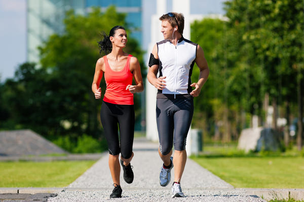 Why might it be that I have pain in my lower legs while jogging, but it stops when i do?