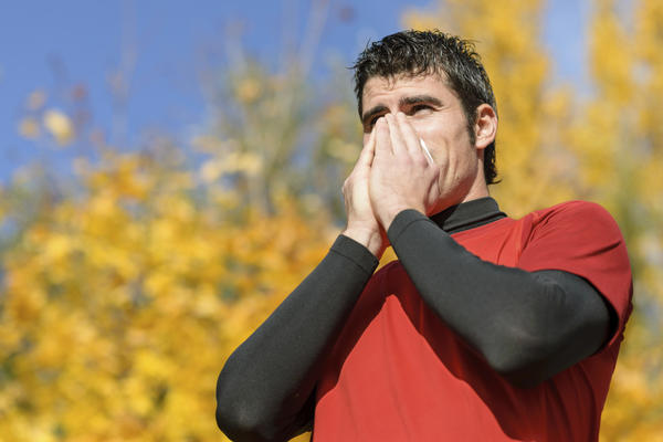 What is a chronic productive cough with spotted mucus a symptom of?