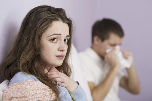 What environmental irritants in a basement apartment would most likely cause a cough?