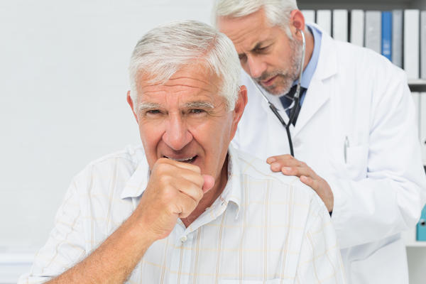 Are coughing up blood and having night sweats symptoms of pneumonia?