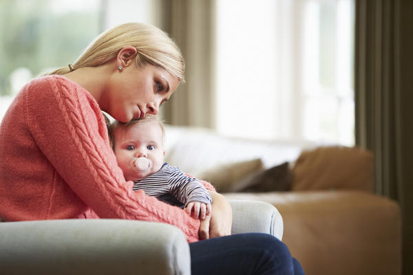 What causes postpartum depression?