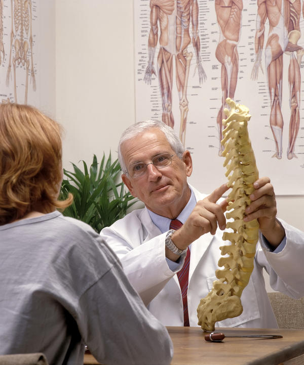 How long do you need to keep rods in your back after scoliosis surgery?