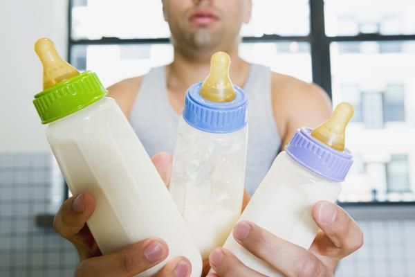 How does the cost of breastfeeding compare to the cost of formula feeding?