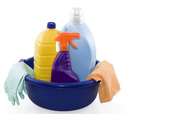 What is the best way to clean germs such as strep pneumoniae off of objects and what cleaning product should be used?