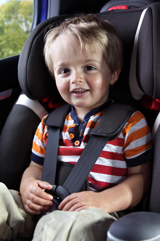 What are some safety precautions I should take for my two week child when traveling by car?