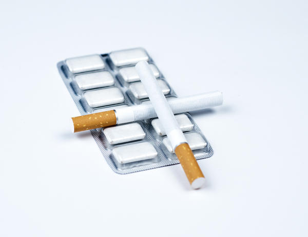 How long should each piece of nicorette (nicotine gum) stay in your mouth?