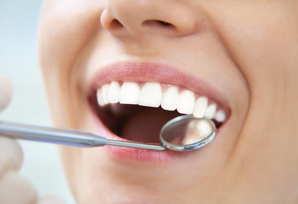 Are swollen gums caused by stress?
