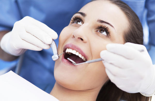 How should you get rid of swollen gums?